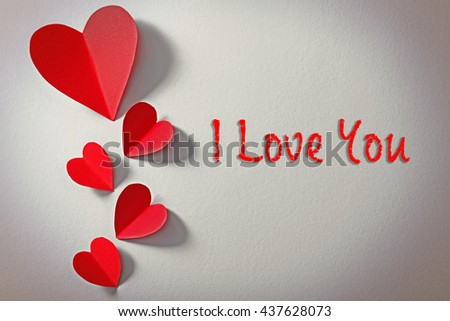 Red paper heart with text I Love You on light background - stock photo