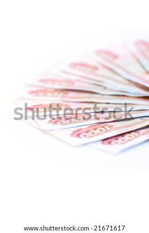Red paper money close up on white - stock photo