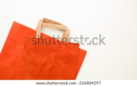 red paper shopping bags on white background - stock photo
