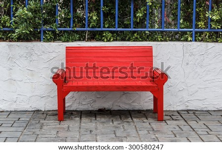 Red park bench in the park. - stock photo
