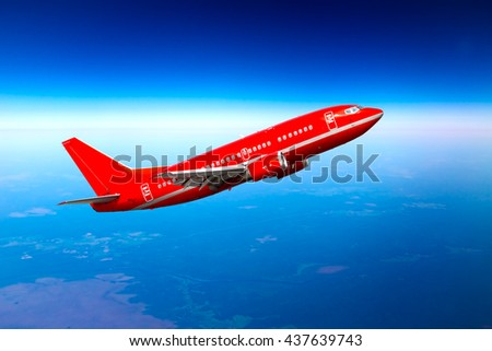 Red passenger aircraft is climb high in the deep-blue sky - stock photo