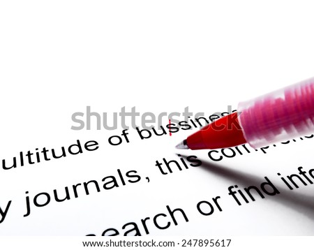 Red pen correcting proofread english text close up - stock photo