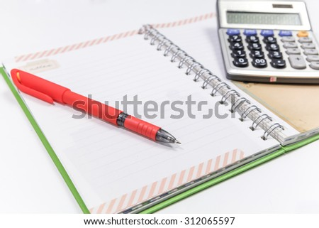 red pen on the blank notebook - stock photo
