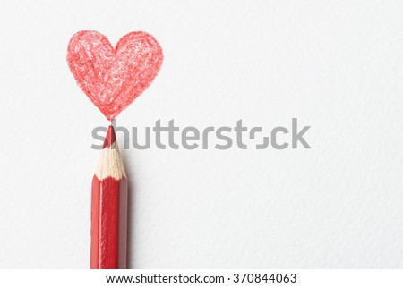 Red pencil and drawn heart against white paper background - stock photo