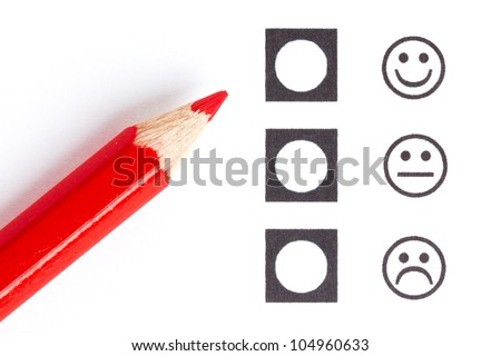 Red pencil choosing the right smiley (mood) - stock photo