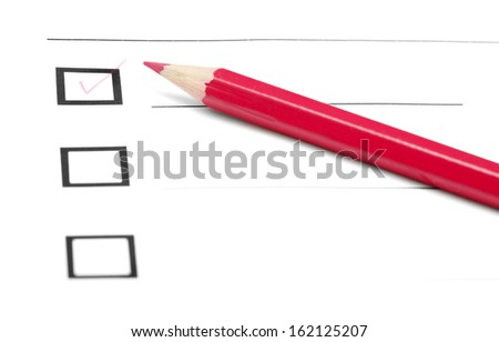 Red pencil on a inquiry form with checkboxes - stock photo