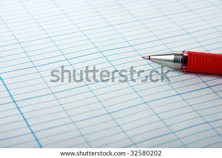 Red pencil on paper - stock photo