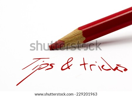 Red pencil - tips and tricks - stock photo