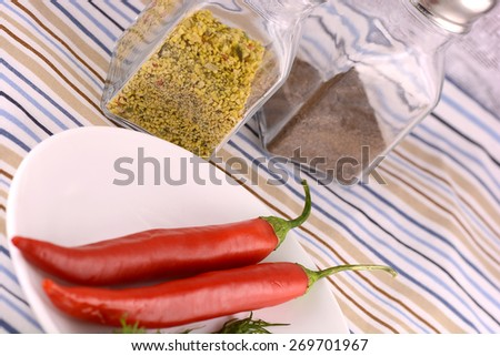red pepper and aromatic herbs leaves still life - stock photo