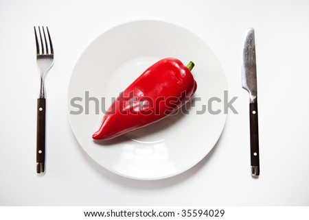Red pepper served on a plate - stock photo