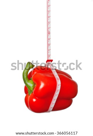Red peppers hanging on the measuring tape - stock photo