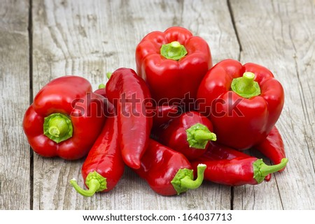 red peppers on wooden background - stock photo