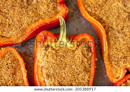 Red peppers stuffed in the pan - stock photo