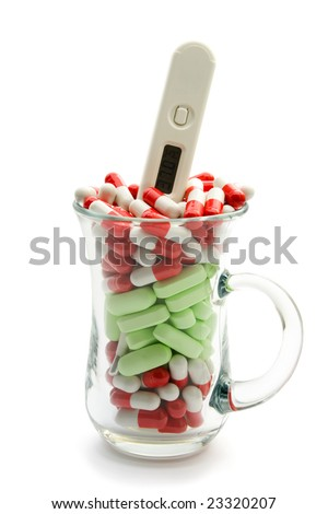 red pill capsule thermometer concept isolated on white background - stock photo
