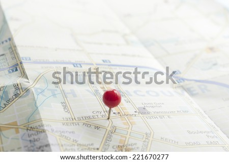 Red pin on the map  - stock photo