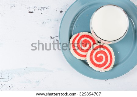 Red Pinwheel Cookies and milk on a plate - stock photo