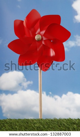 Red pinwheel toy and sky - stock photo