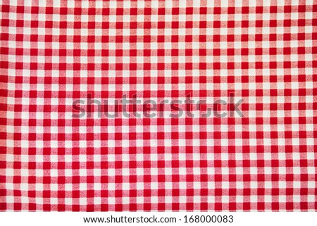 Red plaid fabric as background - stock photo