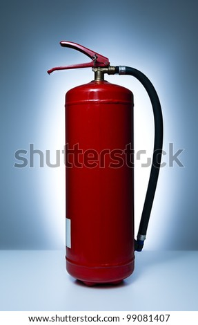 Red plain fire extinguisher - stock photo