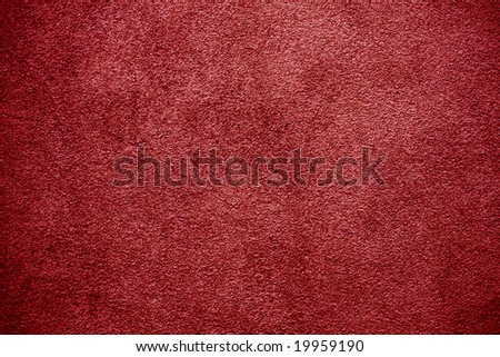 Red plaster wall background. - stock photo