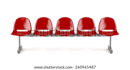 Red plastic chairs at the bus stop - stock photo