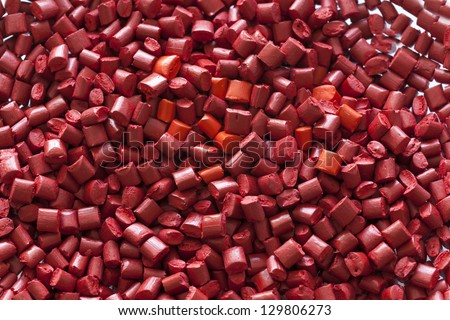 Red plastic granules - stock photo
