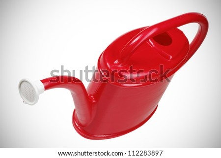 red plastic watering can. isolated on white background - stock photo
