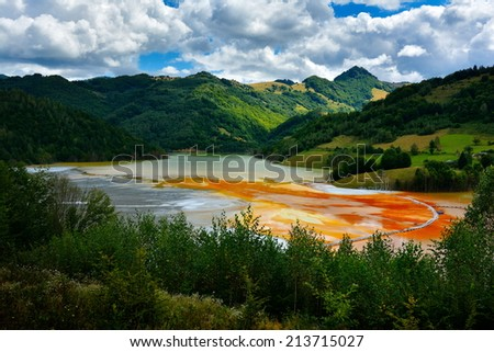 red polluted  lake in Romania, Alba, Geamana - stock photo