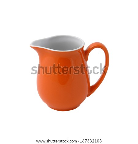 Red porcelain jug - stock photo