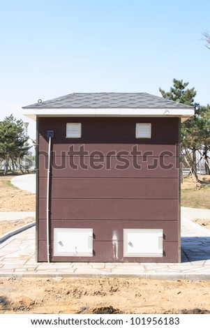 red portable public toilet - stock photo