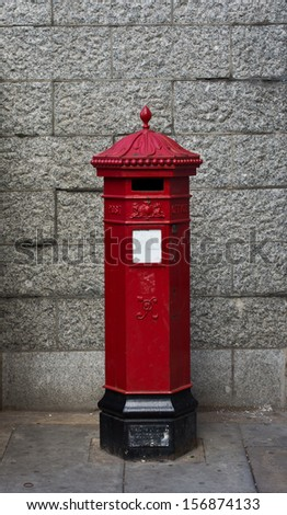Red post box in London. - stock photo