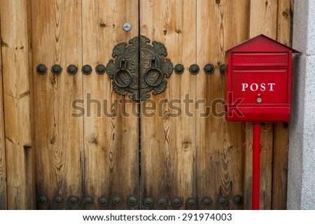 red post box or mailbox postbox letterbox on the street - stock photo