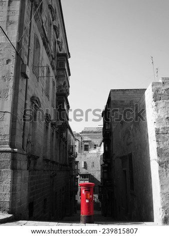 Red postbox in the Valletta historical center in black and white, Valletta, MALTA - stock photo