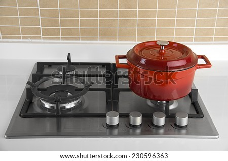 Red Pot on Stove - stock photo