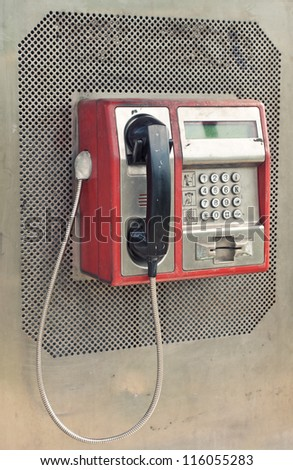Red public phone in retro style - stock photo