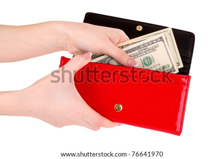 red purse with dollars in the hands on a white background - stock photo