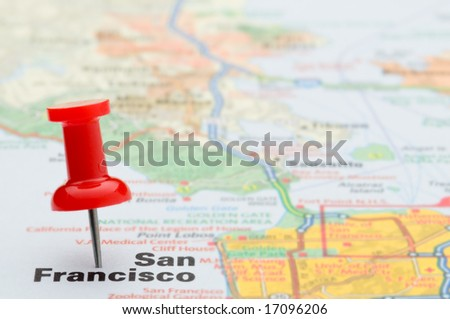Red pushpin marking the location of the city of San Francisco on a road map, selective focus - stock photo