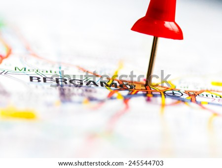 Red pushpin showing Bergamo City On Map, Italy, Travel Destination Concept - stock photo