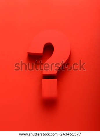 Red question mark on a red background in a conceptual image of a question, query, problem, interrogative, solution, search and answer - stock photo