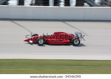 Red race-car on race track No. 1 - stock photo