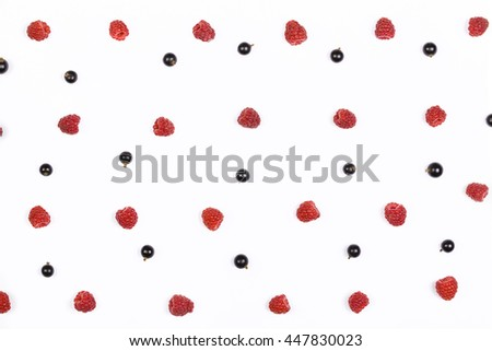 Red raspberry and black currant pattern on white background. Top view. Flat lay. - stock photo