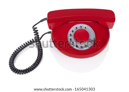 Red retro phone isolated on white background. Retro objects from the sixties. - stock photo