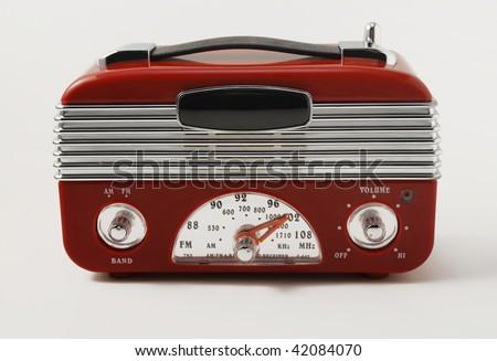 red retro radio isolated on light background - stock photo