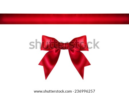 Red ribbon bow on white background. Studio shot. Free space for text  - stock photo