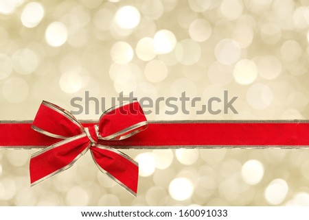 Red ribbon bow with bokeh,Christmas decoration. - stock photo