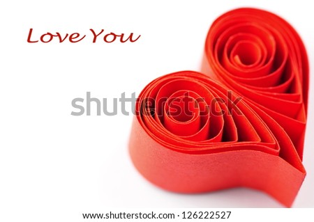 Red ribbon heart on white background - stock photo