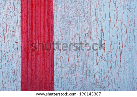 Red ribbon on shabby blue red background with crackles - stock photo