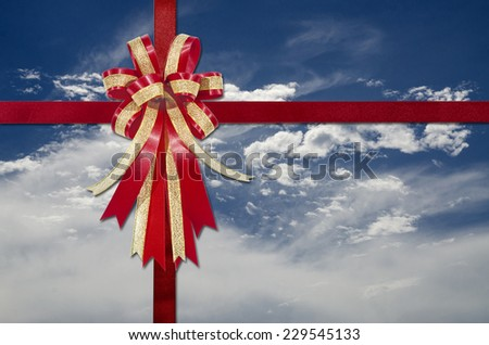 Red Ribbon on white clouds and blue sky for background - stock photo