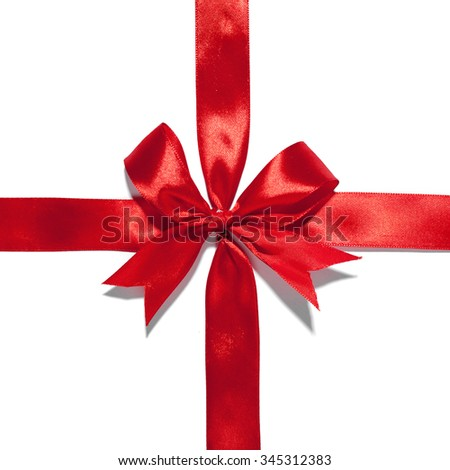 Red ribbon with bow on white. Studio shot - stock photo