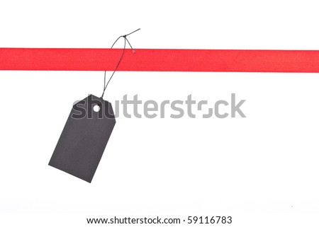 Red ribbon with tag - stock photo